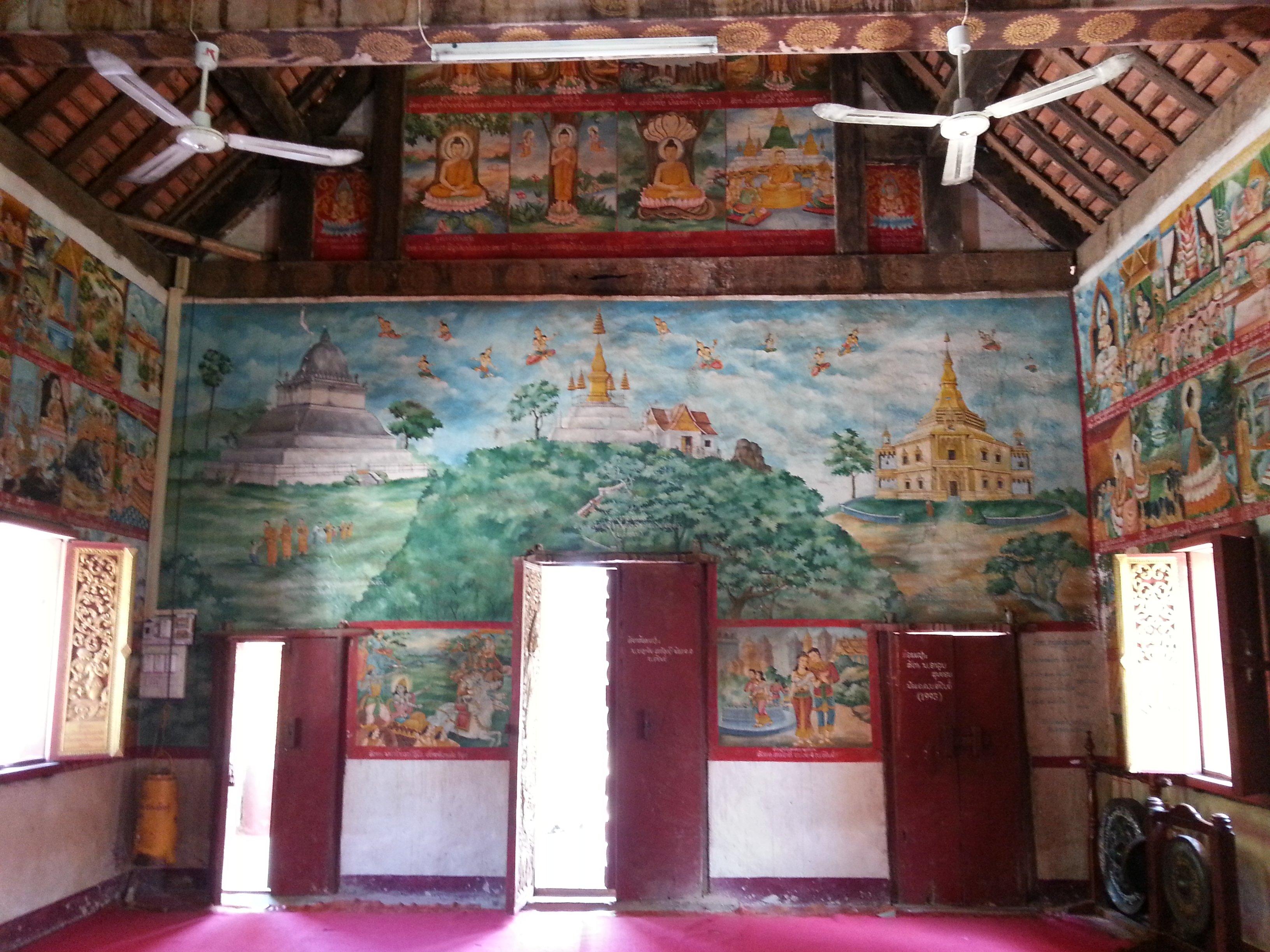 Murals telling the history of Luang Prabang