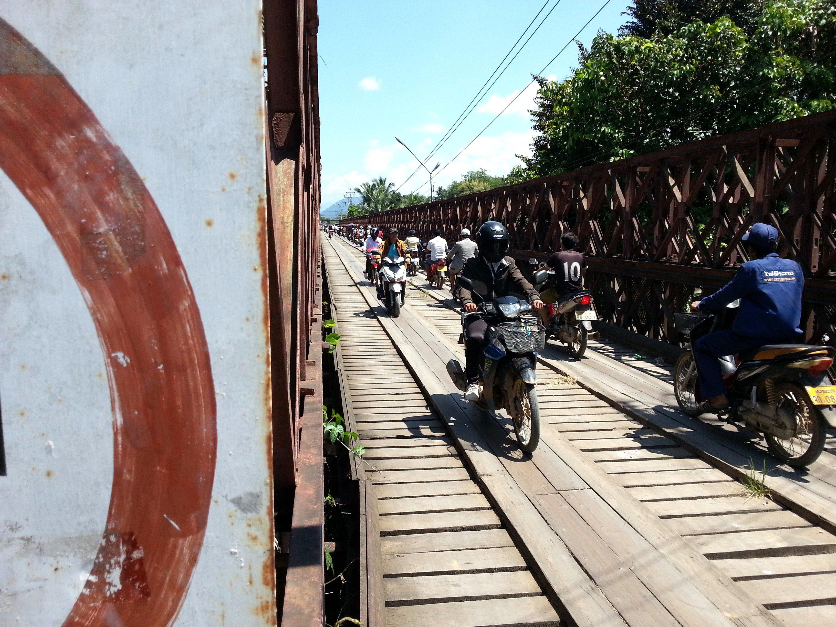 Motorcycles on the Old Bridge in Luang Prabang