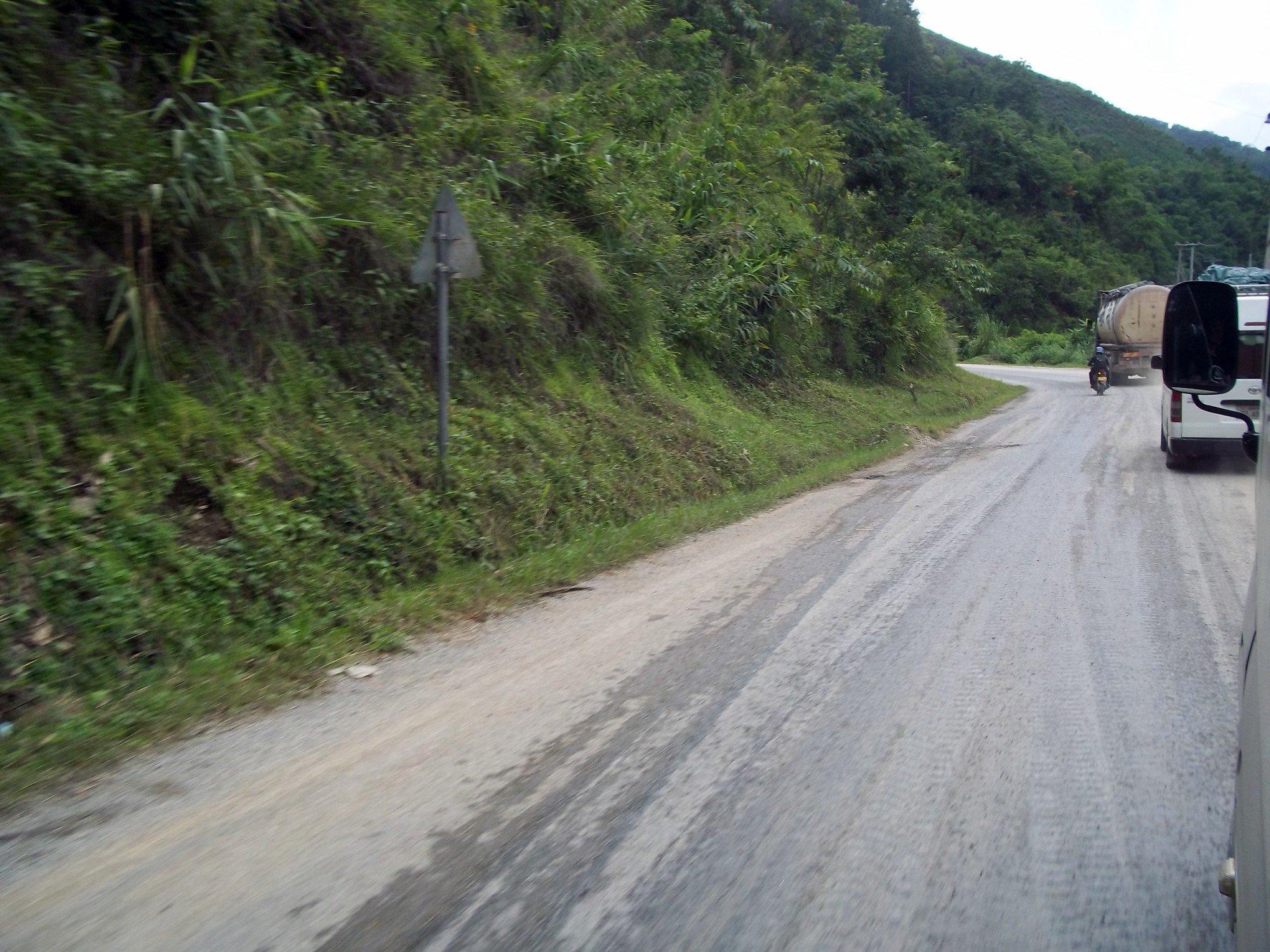 Narrow and busy road from Luang Prabang to Phonsavan